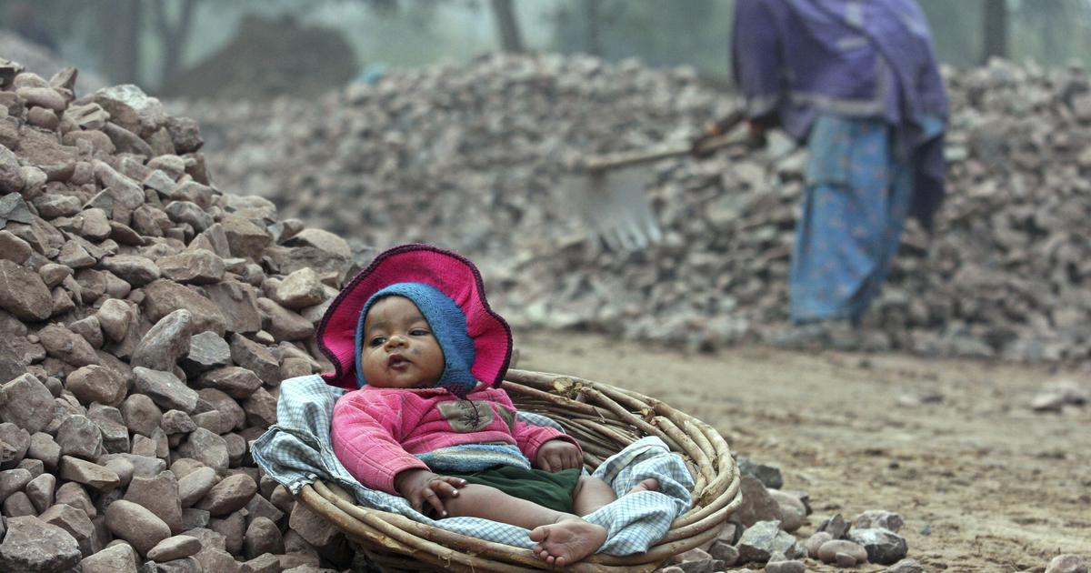 Baby in basket in construction site